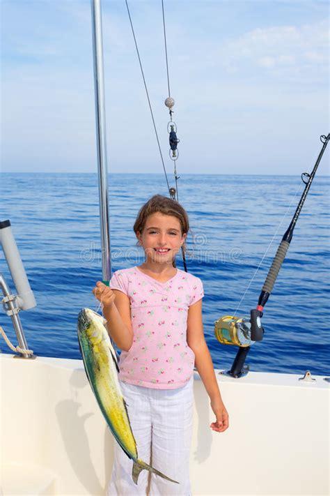 el dorado fishing boat child girl fishing in boat with mahi mahi dorado fish