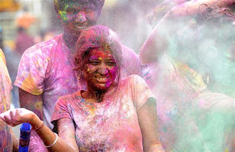 celebrating holi festival of colors in india