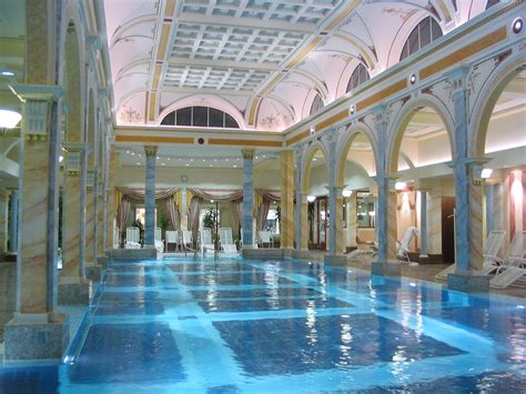 15 of the best indoor hotel pools in the world escapehere best indoor swimming pool backyard design ideas