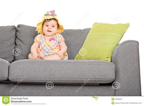 couch baby adorable little baby seated on a couch stock photo image