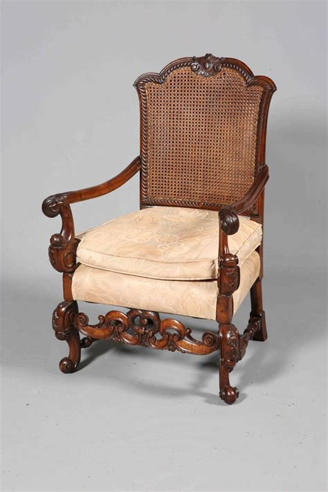 double armchair a carolean style walnut armchair with double walled canewor