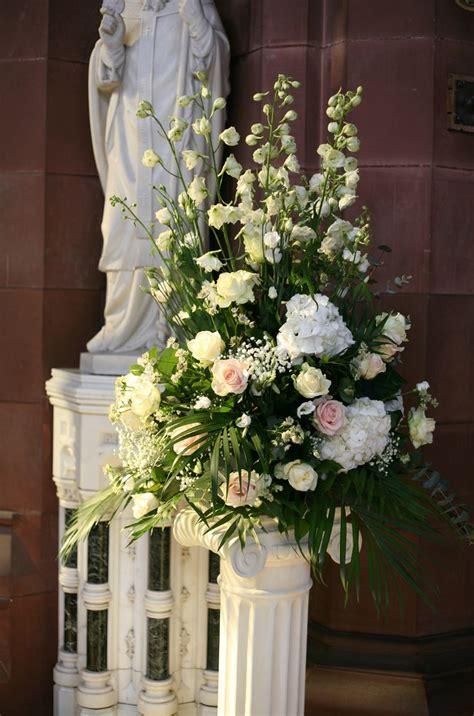 church pedestal arrangement  white delphiniums
