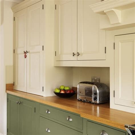 green and cream kitchen cupboards step inside this traditional muted green