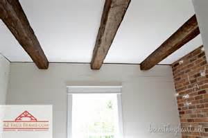 installing faux wood beams in our master bathroom