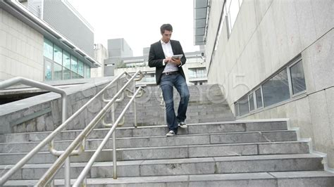 building a single stair walk up better cities towns man walking down stairs with tablet hi res video 14830131
