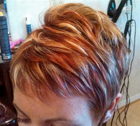 pixie blonde hair with brown low lights womens short hair cut with red and blond highlights