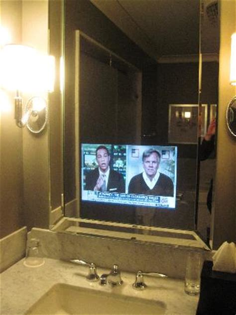 tv in mirror in bathroom elysian front lobby picture of waldorf astoria chicago