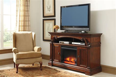 tv in front of fireplace alymere lg tv stand with fireplace option w669 68 ashley