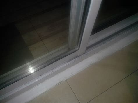Patio Door Weather Stripping How Do I Weatherstrip The Bottom Side Of My Sliding Patio Door Home Improvement Stack Exchange