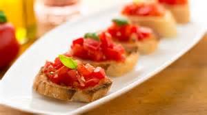 Bruschetta pronounced broo skayt tah is a simple dish with fresh