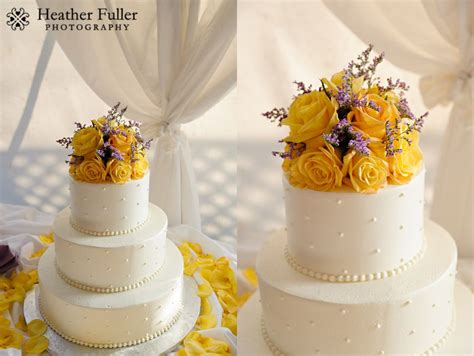Wedding Cakes With Yellow And Purple Flowers by Fuller Photography The Colonial Hotel