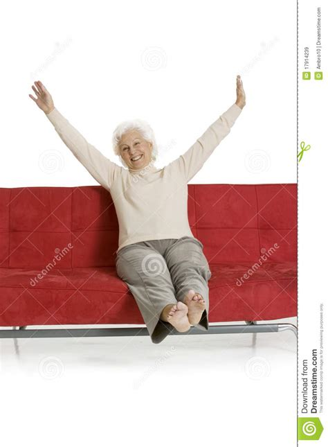 relaxing on the couch elderly woman relaxing on the couch royalty free stock