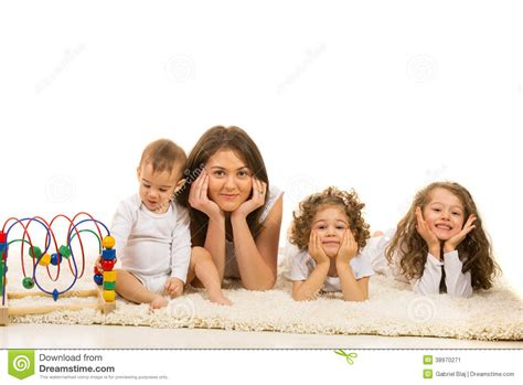 beautiful family beautiful family laying in a row on carpet stock image