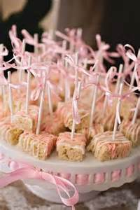 rice krispie treats with white and pink chocolate drizzle