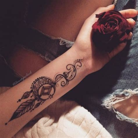 picture of a boho dream catcher arm tattoo