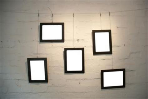 hanging pictures with wire and arranging and grouping wall pictures lovetoknow