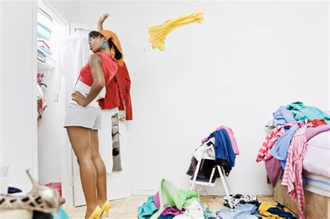 cleaning out your wardrobe woman in closet