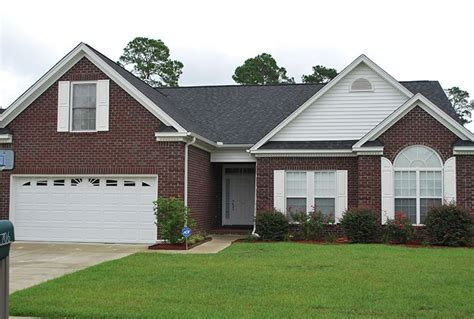 Small Brick Home Curb Appeal Classic Features Such As Semicircular Arches Soldier