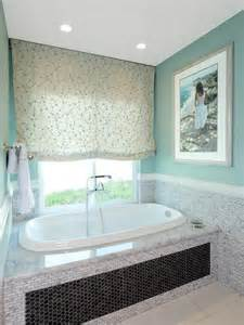 teal master bathroom with soaker tub designers