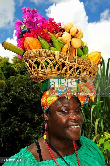woman with fruit basket on head fruit lady woman carrying a fruit basket on her head