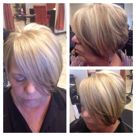 under crown area hilights asymmetrical haircut with a blonde base platinum