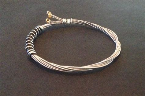 how to make jewelry out of guitar strings a handmade recycled guitar string bracelet bangle bound with