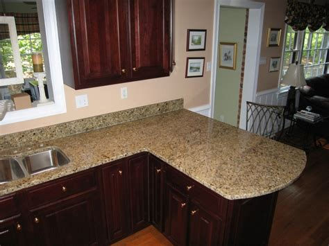 New Granite Countertops Darker Wood Cabinets With Our Venetian Gold Granite