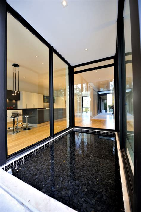 glass house interior design glass house by dcam homes