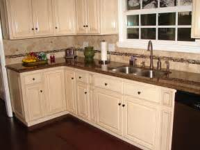 White Kitchen Cabinets With Brown Countertops Antique White Raised Panel Cabinets And Tropical Brown Granite Counter Tops Travertine Glass