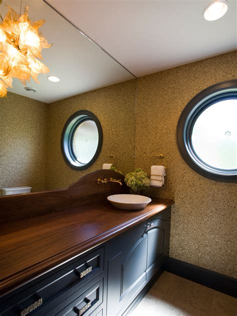 rich wood bathroom countertops and dazzling wall treatment