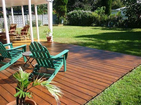 heres  gorgeous backyard ground level deck landscape