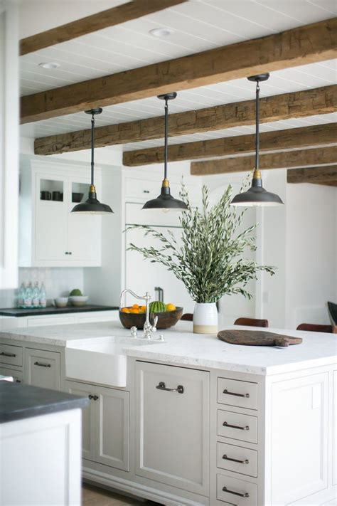 rustic beams and pendant lights a large kitchen