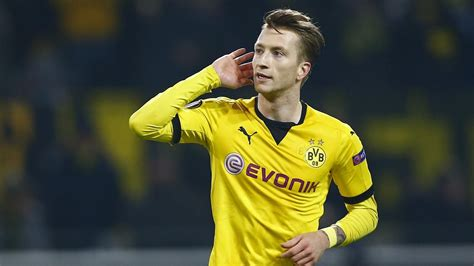 marco reus strikes   borussia dortmund crush spurs