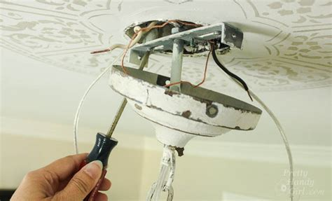 How To Install A Ceiling Light Fixture Without Existing Wiring Installing Light Fixture In Ceiling Mouthtoears
