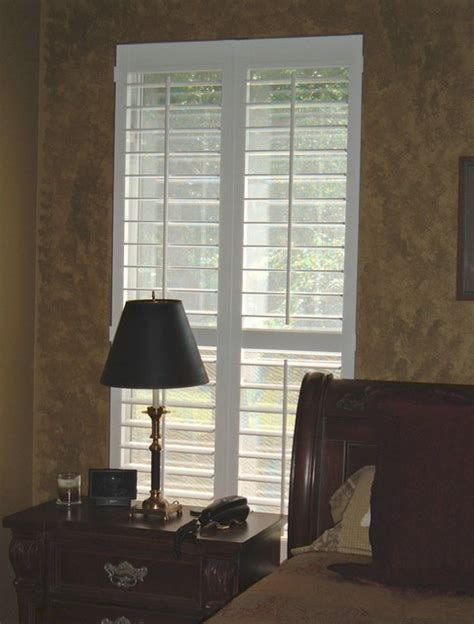 plantation shutters in bedroom bedroom plantation shutters mediterranean charleston
