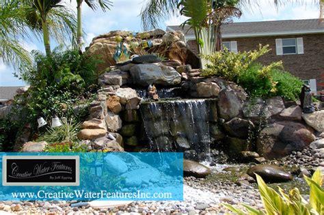 Large Backyard Pond by Large Backyard Waterfall With Pond Tropical Orlando