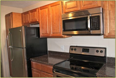 cherry cabinets with granite countertops light cherry cabinets free dark cabinets in small kitchen
