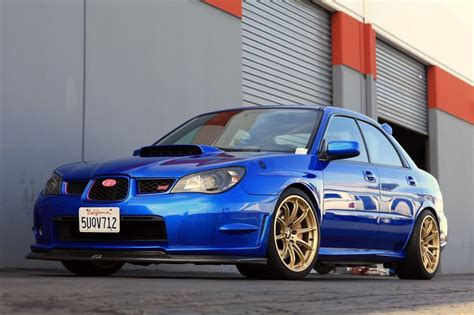 blue subaru gold rims how the blue car matches withe gold rims my identity