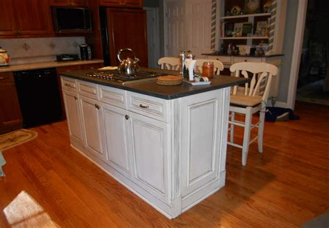 Kitchen Cabinets Island | kitchen cabinet island with white color and black top