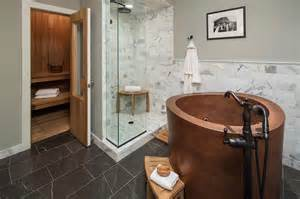 country bathroom with freestanding copper bathtub