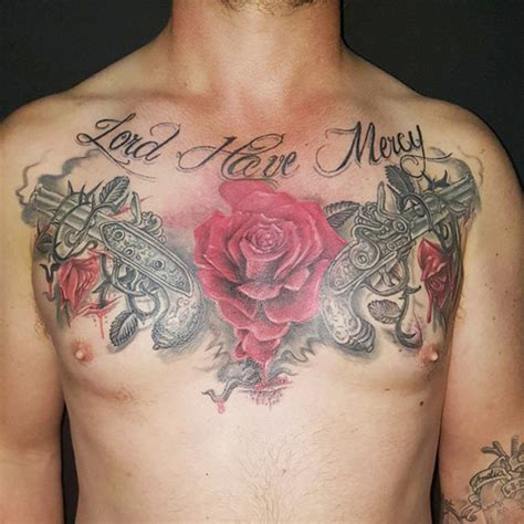 chest tattoo with roses rose and guns tattoos on chest