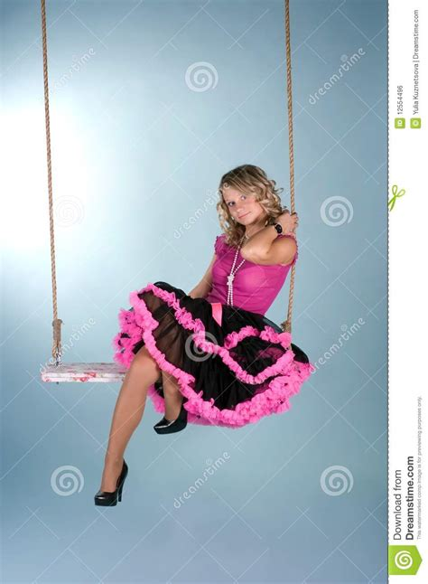 woman on a swing pretty girl sitting on the swing royalty free stock image