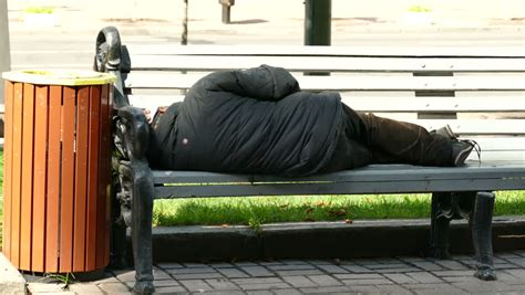 homeless bench homeless man sleeping bench stock footage video shutterstock