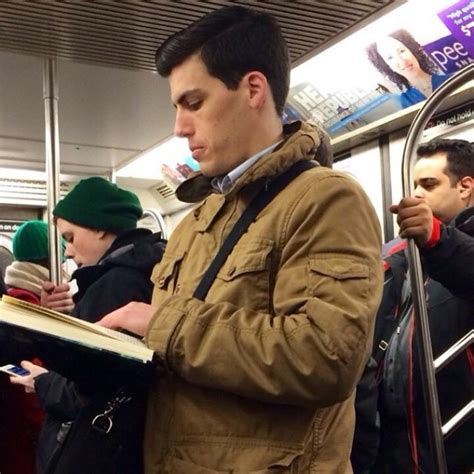 hot dudes reading books on trains is the hottest