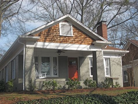 warm house colors warm gray with white trim and brown roof like the orange
