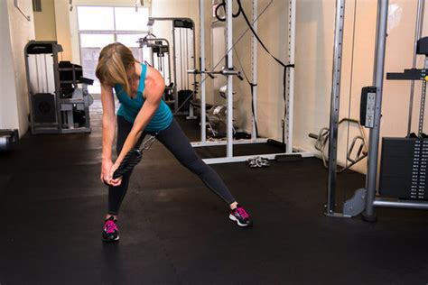 how to do wood chop with cable pulley machine popsugar fitness