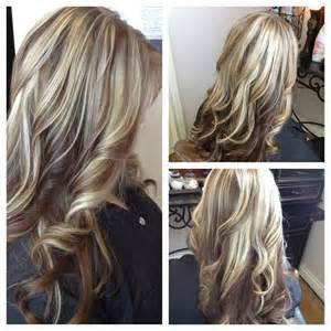 lowlighting the hair the top layer long blonde hair with red lowlights loosely curled