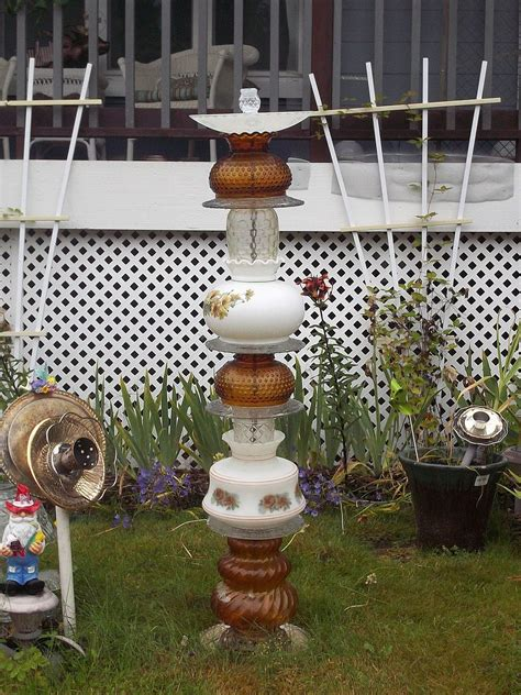 hometalk recycled glassware  lamps  garden totems