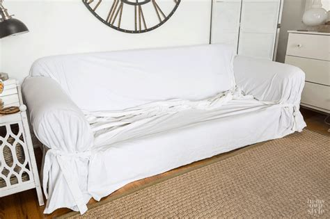 how to put slipcover on sofa why i living with white slipcovers in my own style