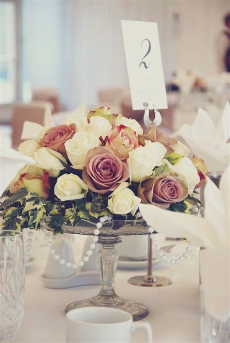 vintage cake stand with roses and pearls wedding ideas